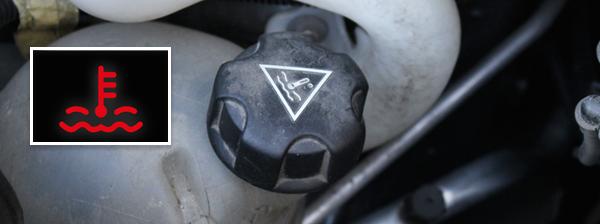 Les symboles relatifs à la jauge de liquide de refroidissement.